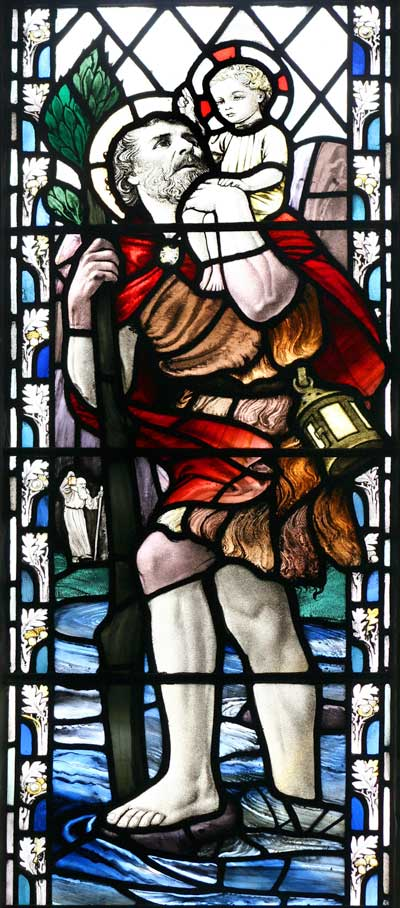 Stained Glass Window of Saint Christopher witht eh Child Jesus on his shoulder